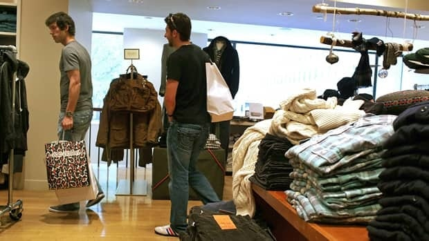 Shoppers explore a New York outlet of apparel retailer J.Crew on Nov. 23, 2010. The chain will open its first Canadian store in Toronto in August.