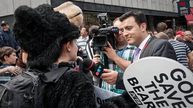 "Kai Nagata, right, interviews protesters for CTV during last week's royal visit in Quebec City. Nagata cited the extensive coverage of what he called the ""Kate and Will show"" as evidence of the lack of credible journalism present in television news."