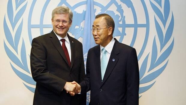 Prime Minister Stephen Harper is welcomed at the United Nations Tuesday by Secretary General Ban Ki-moon. Harper attended a meeting on Libya's future and pledged support.