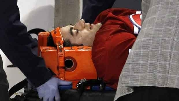 Montreal Canadiens' Max Pacioretty is wheeled away on a stretcher after taking a hit by Boston Bruins' Zdeno Chara during the second period on March 8 in Montreal. There has been a gradual increase in post-concussion time loss for NHL players, researchers say.