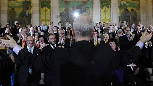 Jack Layton and his NDP caucus meet together as the Official Opposition for the first time, in May, 2011.