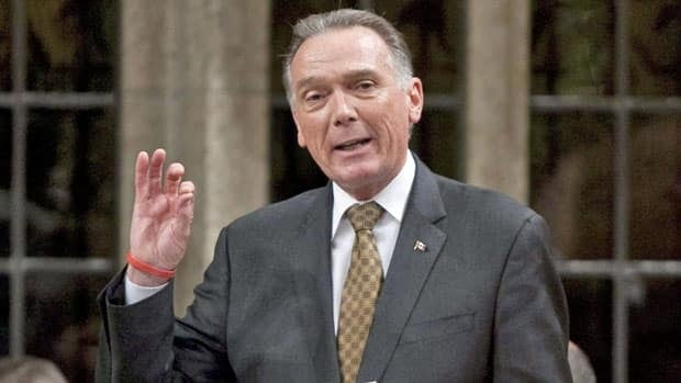 Environment Minister Peter Kent answers questions in the House of Commons last week about budget cuts. The loss of federal government funding has forced the Canadian Environmental Network to shutter its Ottawa headquarters.