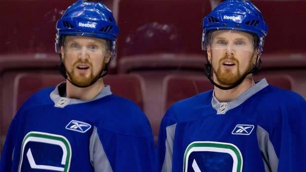 Vancouver forwards Henrik Sedin, left, and his twin brother Daniel Sedin, right, will be matched up against Boston's formidable defensive duo of Zdeno Chara and Dennis Seidenberg during the Stanley Cup Final.
