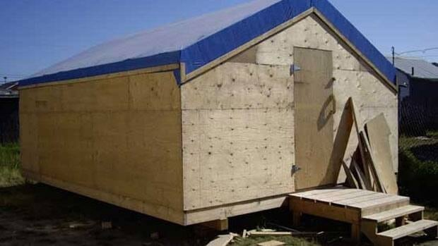 Households in the Attawapiskat First Nation are so crowded, families are building shacks and tent frames to handle the overflow.
