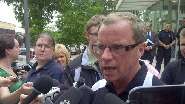 Saskatchewan Premier Brad Wall, shown speaking to reporters in Weyburn earlier this week, is demanding that striking crop insurance workers go back to work.