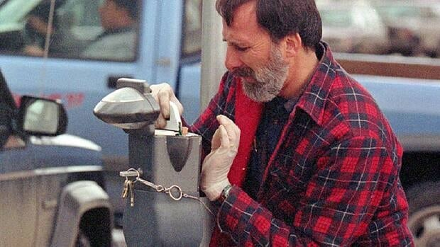Roy Chalmers works for the City of Calgary Parking Meter division, fixing' jammed meters. Hospital parking fees should be abolished, a medical journal editor says.