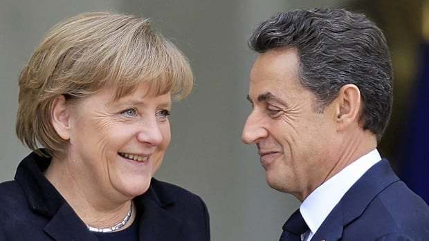 France's President Nicolas Sarkozy, right, greets German Chancellor Angela Merkel before a working lunch at the Elysee Palace in Paris Monday.