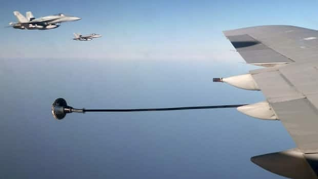 Canadian F-18 war planes (left) wait to refuel from a British VC-10 tanker aircraft over the Mediterranean Sea off Libya on July 10, 2011.