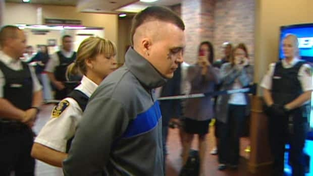 Philip Wayne Pynn was escorted to provincial court under heavy security Tuesday. He is charged with second-degree murder in the death of Nick Winsor.