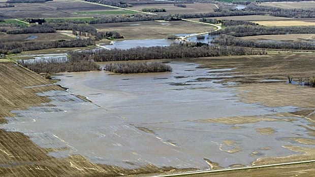 Floodwater from a breach at the Hoop and Holler Bend in Manitoba fans out from the Assiniboine River to surrounding fields outside Portage la Prairie on Saturday.