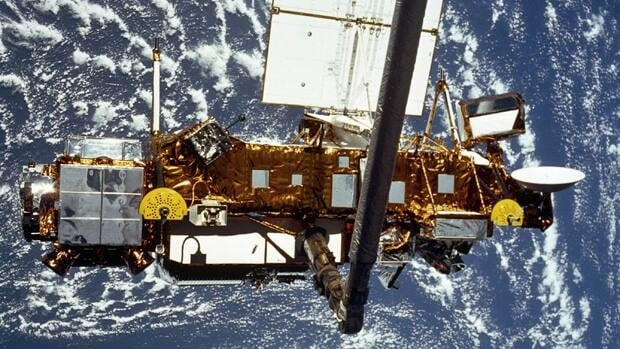 The Upper Atmosphere Research Satellite (UARS) in the grasp of the RMS (Remote Manipulator System) during deployment, from the shuttle in September 1991.