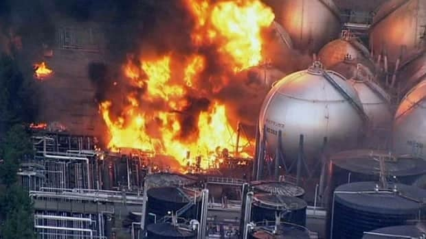An image taken from Japan's NHK TV, shows an oil refinery burning in Ichihara, Japan, after a massive earthquake Friday.