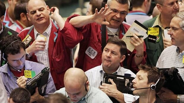Oil options traders work at the New York Mercantile Exchange. Oil prices reached fresh 30-month highs Friday.