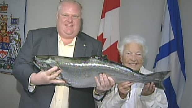 Toronto Mayor Rob Ford shows off a gift of an 18-pound salmon from Mississauga Mayor Hazel McCallion, who caught the fish herself.