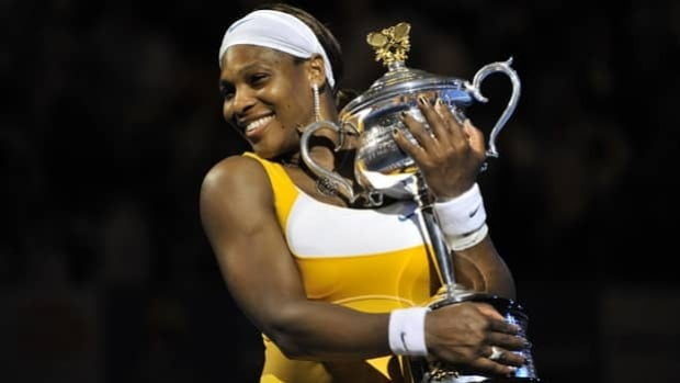 Serena Williams poses with the trophy after victory in her women's singles final match against Belgian opponent Justine Henin at the Australian Open tennis tournament in Melbourne on January 30, 2010.  Williams won 6-4. 3-6. 6-2. (Paul Crock/Getty Images)