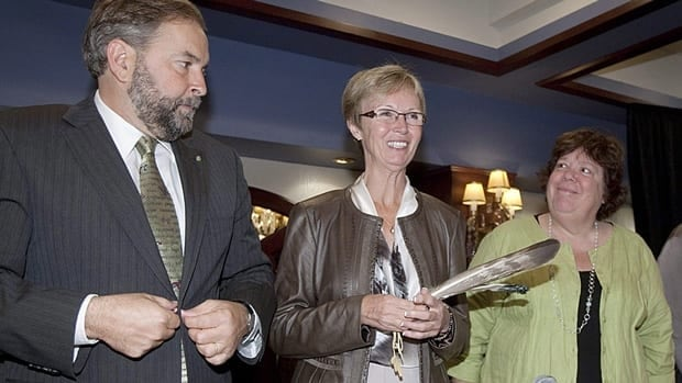 Interim NDP Leader Nycole Turmel, centre, stands with deputy leaders Thomas Mulcair, left, and Libby Davies at the party's caucus retreat in Quebec City Wednesday. Some NDP MPs have been voicing support for a leadership run by Mulcair, who has yet to declare his candidacy.
