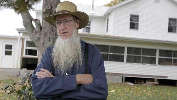 Sam Mullet stands in front of his Bergholz, Ohio home on Monday Oct. 10, 2011.
