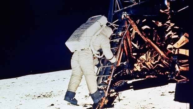 Astronaut Edwin E. Aldrin, Jr., descends the steps of the Lunar Module ladder as he prepares to walk on the moon in this file photo from July 20, 1969.