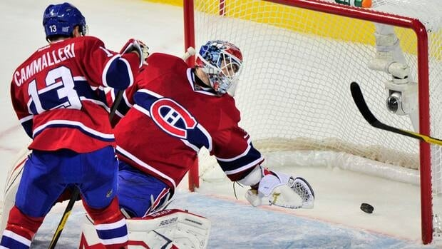 Montreal Canadiens goalie Peter Budaj and Mike Cammalleri watch the puck go into the net on a goal by Florida Panthers' Tomas Fleischmann during the first period on Monday in Montreal.