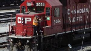 Canadian Pacific locomotive and brakeman hi-cp02654134-train