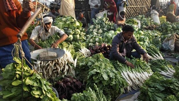 Indian vendors sell vegetables at a market in Allahabad, India, on Feb. 19, 2011. Inflation is climbing across Asia as the cost of food jumps, echoing the previous global food crisis that peaked in 2008. (Rajesh Kumar Singh/Associated Press)