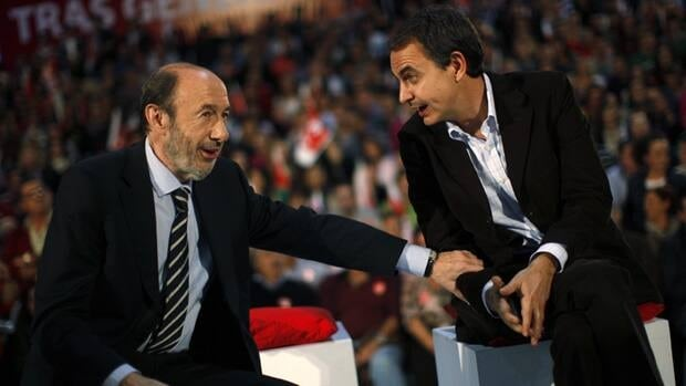 Socialist candidate for prime minister Alfredo Perez Rubalcaba, left, confers with Spain's current PM, Jose Luis Rodriguez Zapatero, before an election rally in Malaga. Zapatero and Rubalcaba's party is expected to be clobbered in Sunday's vote.