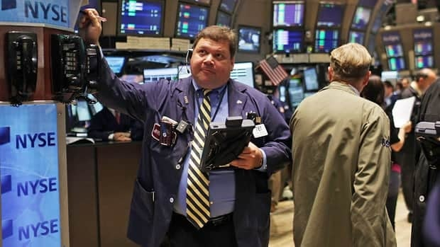 North American markets rose Friday despite conflicting news about the health of the global economy.