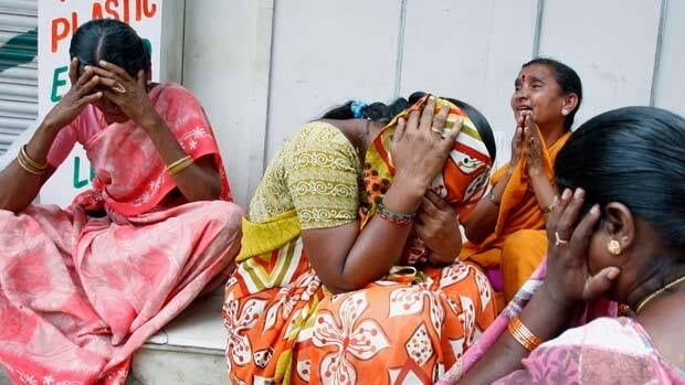 Devotees grieve on hearing the news of the Hindu holy man Sathya Sai Baba's death, outside Baba's ashram in Puttaparti, about 450 kilometres from Hyderabad, India.
