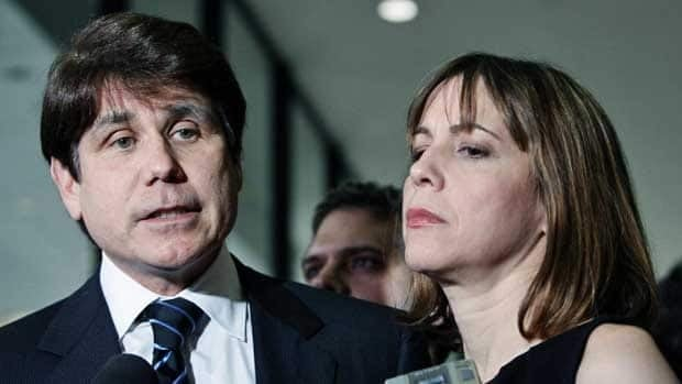 Former Illinois governor Rod Blagojevich, left, and his wife Patti talk with reporters outside court on June 9 in Chicago. Jurors reached a verdict Monday in most of the charges against him.