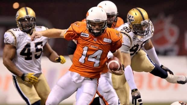 B.C. Lions quarterback Travis Lulay scrambles with the ball as Winnipeg Blue Bombers defenders give chase during Sunday's Grey Cup game.