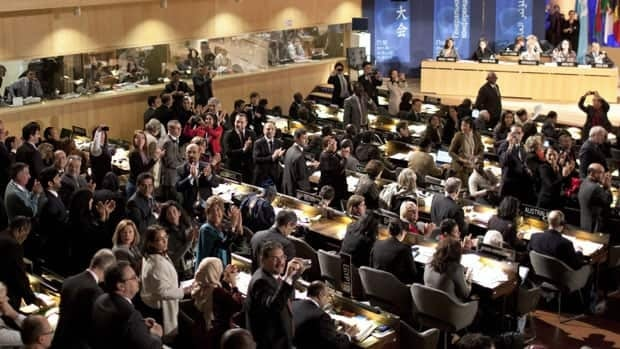 Delegates cheer after approving Palestinian membership in a 107-14 vote with 52 abstentions during UNESCO's 36th General Conference in Paris on Monday.