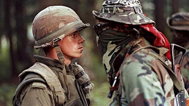 Canadian soldier Patrick Cloutier and Mohawk protester Brad Larocque (also known as Freddy Krueger) come face to face in a tense standoff at the Kanesatake reserve in Oka, Que., on Sept. 1, 1990.