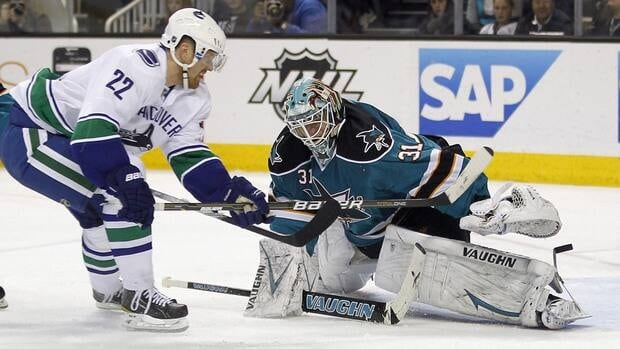 San Jose Sharks goalie Antti Niemi, right, blocks a shot attempt by Vancouver Canucks left wing Daniel Sedin on Wednesday night.