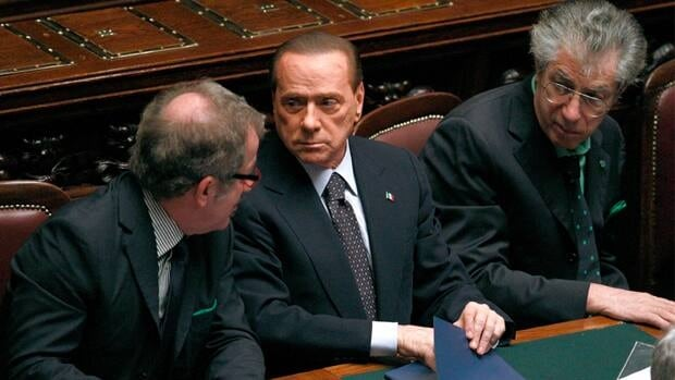 On Nov. 9, the day after Italian Prime Minister Silvio Berlusconi, centre, announced his resignation, the country's bond rate surged over seven percent. Greece, Portugal and Ireland all asked for bailouts after hitting that bond rate.
