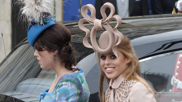 The hat worn by Princess Beatrice of York (right, shown with her sister Princess Eugenie of York) at the April 29 royal wedding will be auctioned off for charity.
