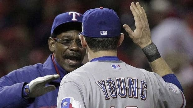 """Rangers manager Ron Washington reacts celebrates the team's Game 2 win over St. Louis with Michael Young. """"When my guys do something good out there, I'm just as excited about it as they are,"""" says Washington."""