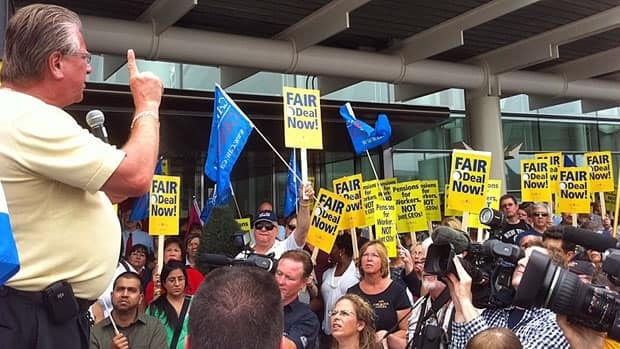 CAW president Ken Lewenza speaks to Air Canada workers rallying outside of Pearson Airport's Terminal 1 last Thursday.
