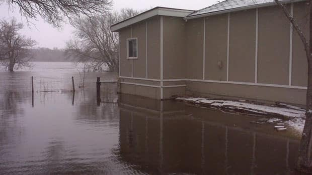The Souris River already spilled its banks back in April, when it flooded this cottage in Melita, Man. The area is bracing for another crest.