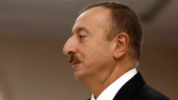Azerbaijan President Ilham Aliyev's election victory that kept his family dynasty in power was marred by violations, international monitors said.