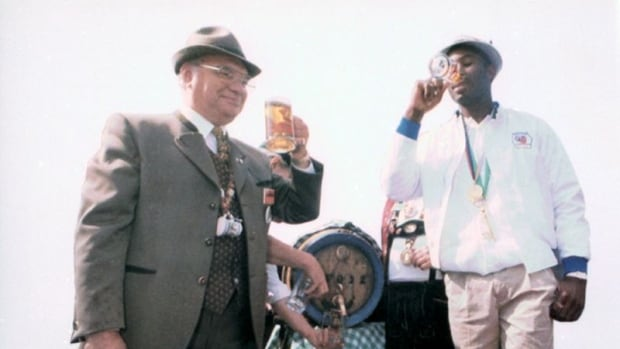 World heavyweight boxing champ, and former Kitchener resident, Lennox Lewis sips beer at Oktoberfest