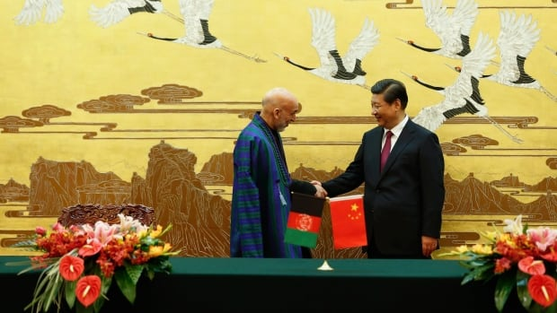 Afghan President Hamid Karzai, left, and Chinese President Xi Jinping meet in the Great Hall of the People in Beijing last month. A Chinese consortium is planning a massive copper mine in Afghanistan, although security concerns have stalled development. Development faces challenges all over, but Canadians must make sure they are making reasoned decisions about projects, Stockwell Day says.