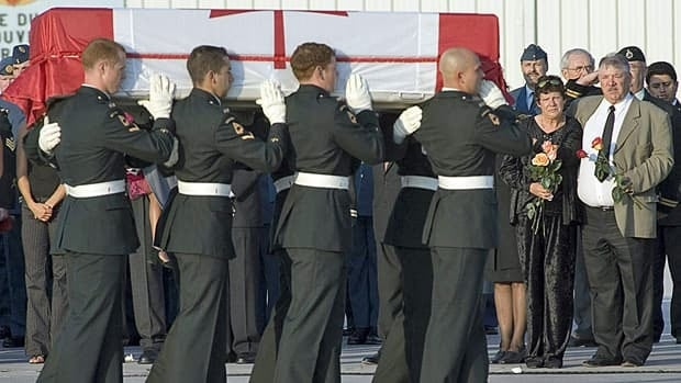 Errol and Elaine Cushley comfort one another as the casket with their son Pte. William Cushley is marched past during the repatriation ceremony in Trenton, Ont., on Sept. 6, 2006.