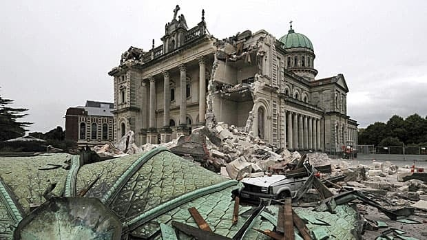Debris crushes a car outside the Christchurch Catholic Cathedral after an earthquake rocked Christchurch, New Zealand, on Tuesday. Engineers have to balance safety with economics and the likelihood of a major quake occurring in a given region when designing buildings, says Samir Chidiac.
