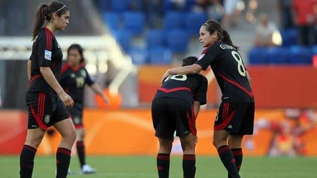 Mexicans Alina Garciamendez (L-R), Veronica Perez and Guadalupe Worbis see their World Cup hopes crumble Tuesday in Sinsheim, Germany. Mexico's draw with New Zealand, combined with England's victory, ousted the women from Group B.