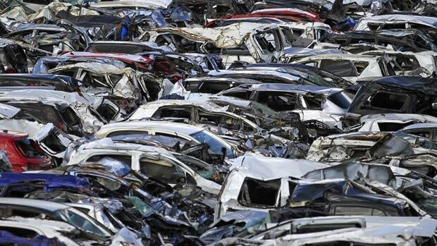 New vehicles damaged by the March 11 tsunami are shown at a Toyota parking lot at Sendai port on Monday.
