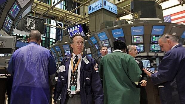 Traders work on the floor of the New York Stock Exchange on Tuesday. REUTERS/Brendan McDermid