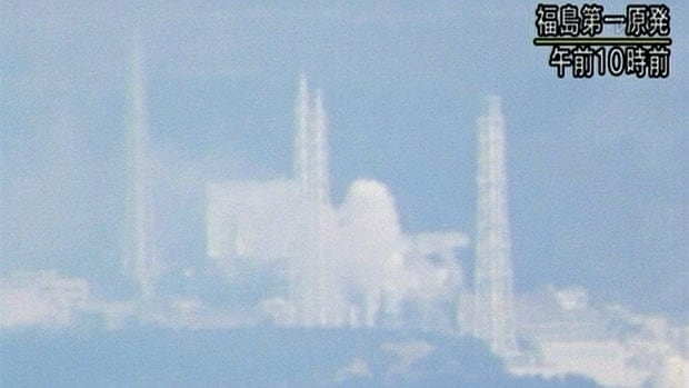 In this image provided by Japan's national broadcaster NHK, white smoke, center, billows from the Fukushima Daiichi nuclear power plant in Okumamachi, Fukushima, on Wednesday morning.