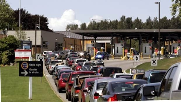 Cars line up to cross the border into Canada from the United States at the Peace Arch border crossing south of Vancouver.