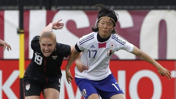United States' Rachel Buehler, left, and Japan's Yuki Nagasato battle for the ball during a recent friendly. On Sunday, they will battle for the Women's World Cup trophy.