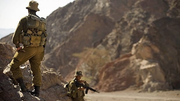 Israeli soldiers on Friday secure the area near roads leading to the sites of several attacks a day earlier in the Arava desert, near the southern Israeli resort town of Eilat.